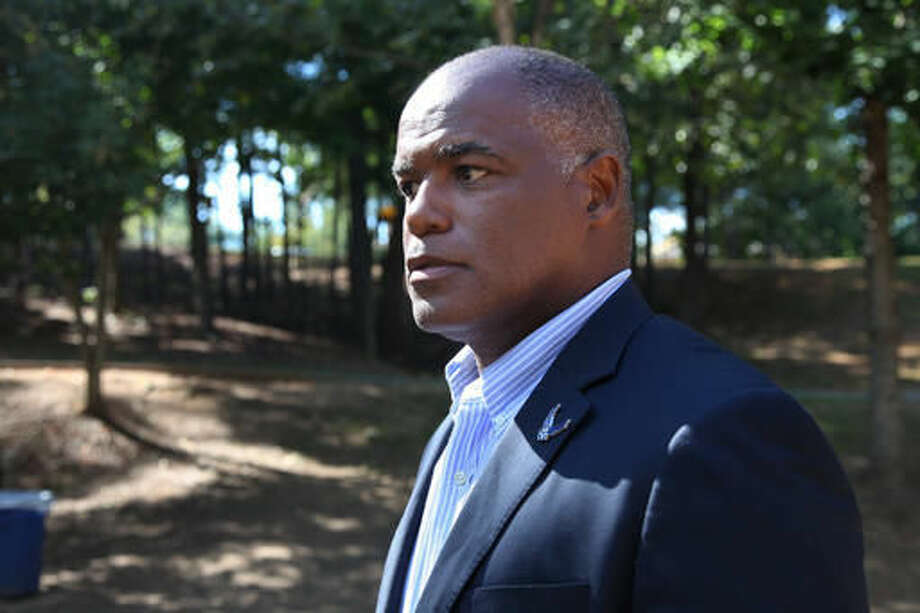 "Gene Folkes of Wylie, Texas, a candidate on the reality television show ""The Apprentice,"" speaks during an interview in the north Atlanta suburb of Johns Creek, Ga., on Saturday, Oct. 1, 2016. In portions of boardroom sessions never broadcast, Donald Trump frequently would ask male contestants to rate the attractiveness of their female competitors, former crew members and contestants said. Folkes, who appeared on the program in 2010, says, ""If you didn't answer, he would dig in and say 'Do you think so and so is attractive? Would you sleep with her? Well, what about if you really had to, would you?' … It was so bizarre, because he (otherwise) seemed so professional."" (AP Photo/Johnny Clark)"