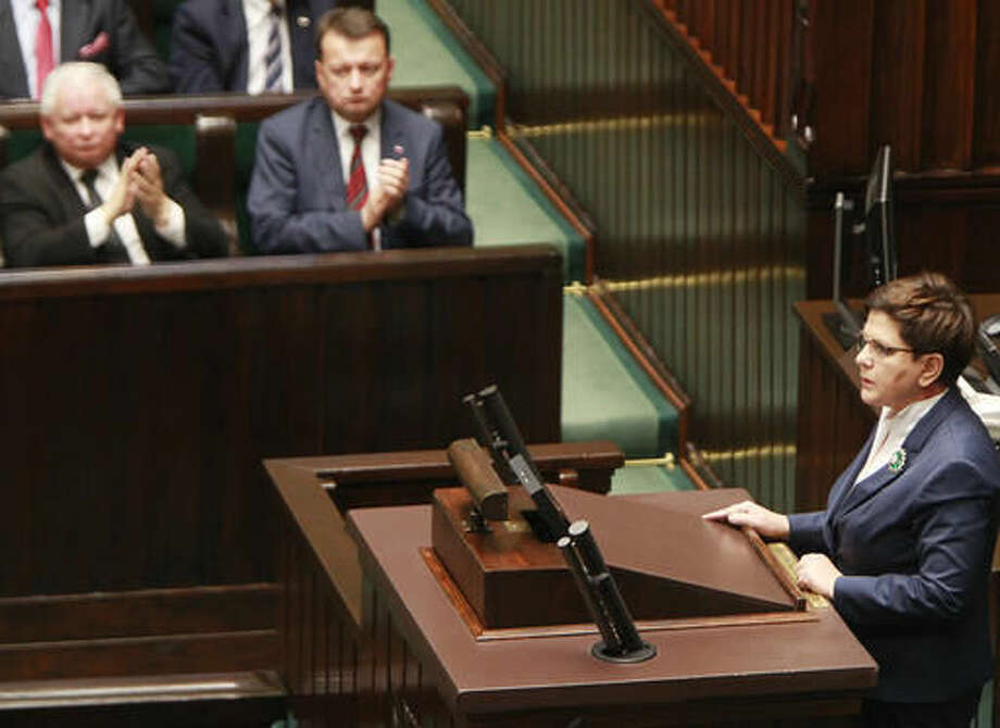 Polish Prime Minister Beata Szydlo, right, addresses lawmakers in the Polish parliament amid a heated debate on a proposal to restrict the abortion law in Warsaw, Poland, on Thursday, Oct. 6, 2016. Polish lawmakers voted overwhelmingly on Thursday to reject a proposal by an anti-abortion group that would have imposed a total ban on abortion, caving in to massive outrage by women who have been dressing in black and waging street protests across the country. (AP Photo/Czarek Sokolowski)