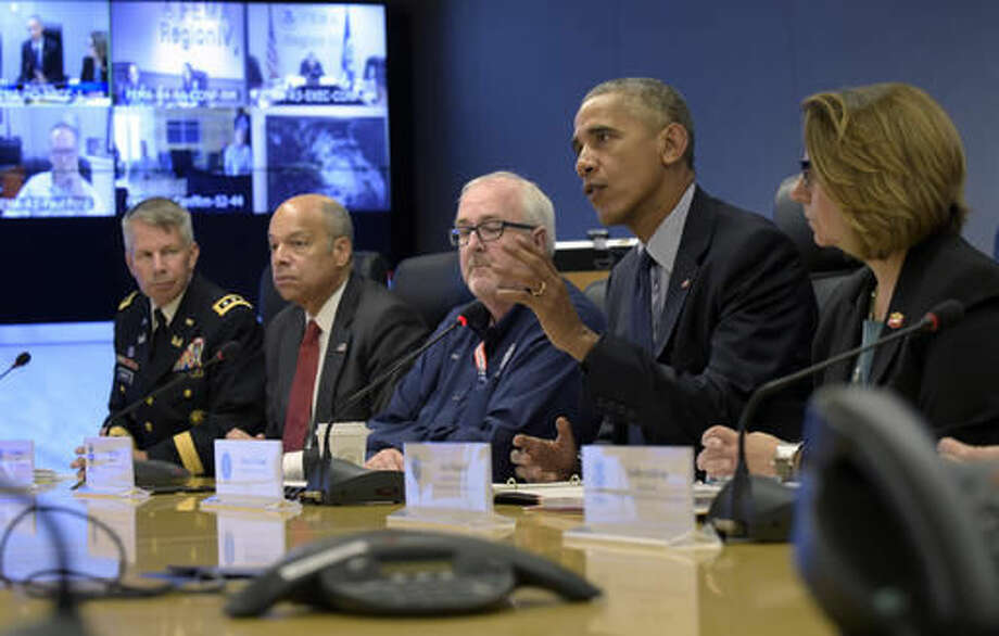 President Barack Obama speaks after getting a briefing on Hurricane Matthew during a visit to FEMA headquarters in Washington, Wednesday, Oct. 5, 2016. From left are, Lt. Gen. Todd T. Semonite, Commanding General and Chief of Engineers, U.S. Army Corps of Engineers, Homeland Secretary Jeh Johnson, Federal Emergency Management Agency Administrator Craig Fugate, and Assistant to the President for Homeland Security and Counterterrorism Lisa Monaco. (AP Photo/Susan Walsh)