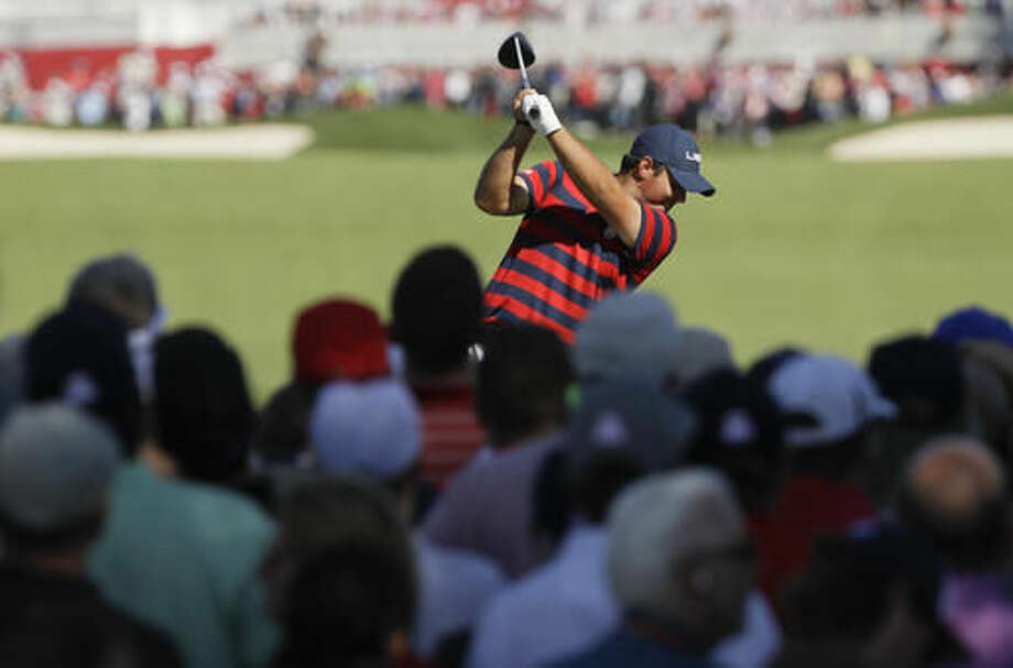 United States' Patrick Reed hits a drive on the second hole during a four-ball match at the Ryder Cup golf tournament Saturday, Oct. 1, 2016, at Hazeltine National Golf Club in Chaska, Minn. (AP Photo/David J. Phillip)