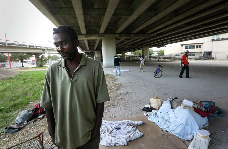 Calvin Walter, who came to Houston a year and a half ago for treatment of a blood disorder, lives under the U.S. 59 overpass in Midtown. The chronically homeless man said he wants a place to call home. Photo: Jon Shapley, Staff / © 2015  Houston Chronicle