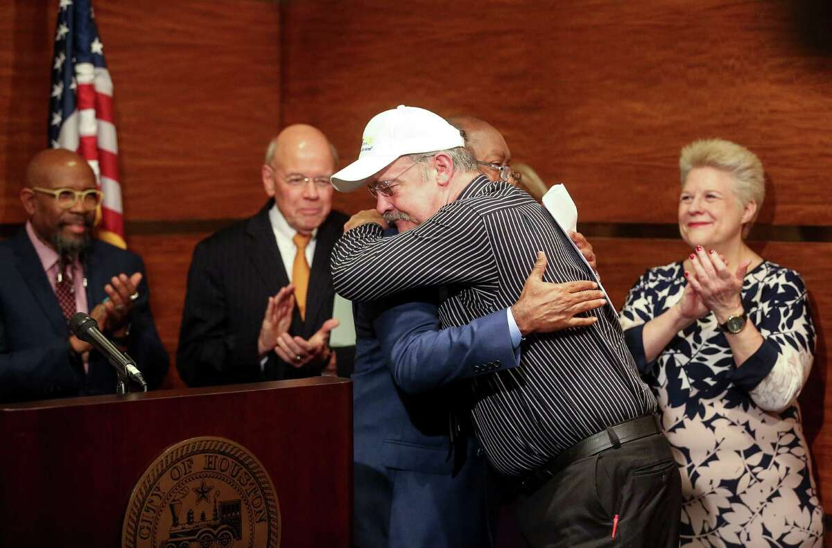 Jay Jeanjaquet, who was previously homeless, hugs Mayor Sylvester Turner during a news conference announcing the $1M grant to help Houston's homeless population.