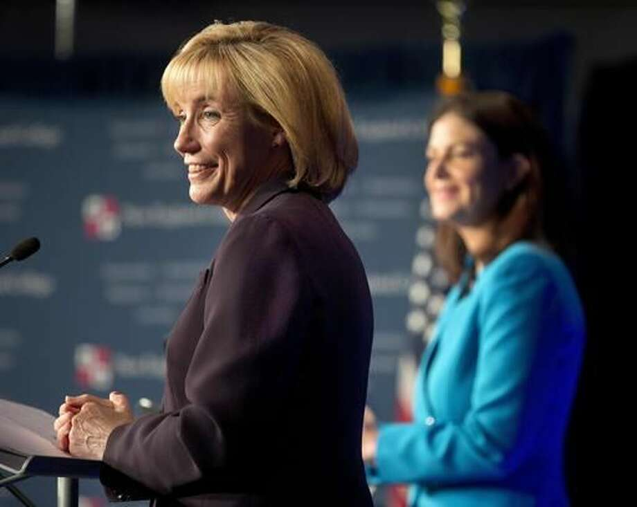 Democratic challenger for U.S. Senate Gov. Maggie Hassan, left, listens to questions during a debate with Incumbent Republican U.S. Sen. Kelly Ayotte, during a live televised debate by New England Cable News at New England College Monday, Oct. 3, 2016, in Henniker, N.H. (AP Photo/Jim Cole)
