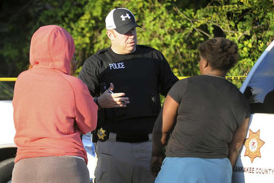 In this Oct. 2, 2016 photo Kankakee County Sheriff's police Lt. Chad Gessner talks at scene of a homicide first discovered on Sunday afternoon in Pembroke Township, Ill. Police in northeastern Illinois said they're investigating multiple homicides in the township, which happened in less than 36 hours. (Scott Anderson/The Daily Journal via AP)