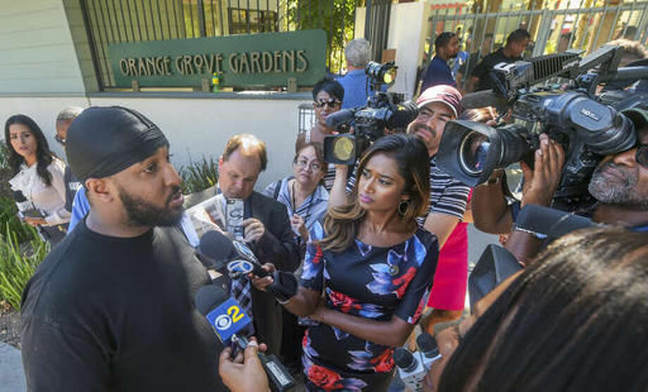 Forest Elder, brother-in-law of victim Reginald Thomas, speaks to members of the media about the death of his relative, who was armed with a knife and reported to be bipolar, who died earlier after a struggle with Pasadena police officers who were called to an apartment early morning Friday, Sept. 30, 2016, at Orange Grove Gardens in Pasadena, Calif. Pasadena police Chief Phillip Sanchez said a fight ensued after the officers used a Taser on the man when he ignored their orders to drop the knife. After he was subdued, officers noticed he wasn't breathing and attempted to revive him, Sanchez said in a statement. Paramedics also tried but failed, and the man was pronounced dead at his apartment in a modest Pasadena neighborhood. (Walt Mancini/The Pasadena Star-News via AP)