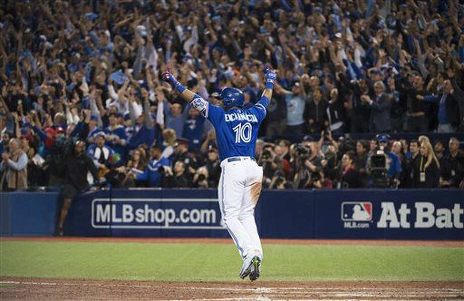 Toronto Blue Jays' Edwin Encarnacion celebrates his game winning walk-off three-run home run against the Baltimore Orioles during the 11th inning of an American League wild-card baseball game in Toronto, Tuesday, Oct. 4, 2016. (Nathan Denette/The Canadian Press via AP)