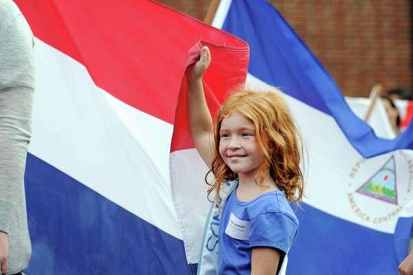 Julian Curtiss School first grade student Harper Spelman carried the flag of The Netherlands.