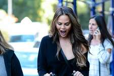 NEW YORK, NY - OCTOBER 14:  Model and television personality Chrissy Teigen (L) walks her daughter Luna Simone Stephens in Tribeca on October 14, 2016 in New York City.  (Photo by Ray Tamarra/GC Images)