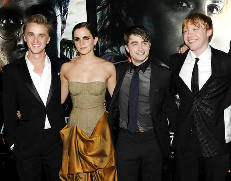 "FILE - In this July 11, 2011 file photo, cast members, from left, Tom Felton, Emma Watson, Daniel Radcliffe and Rupert Grint pose together at the premiere of ""Harry Potter and the Deathly Hallows: Part 2"" at Avery Fisher Hall in New York. Warner Bros. said on Oct. 3, 2016, that all 8 Harry Potter films will be re-released in theaters for a one-week run beginning Oct. 13, 2016. (AP Photo/Evan Agostini, File)"