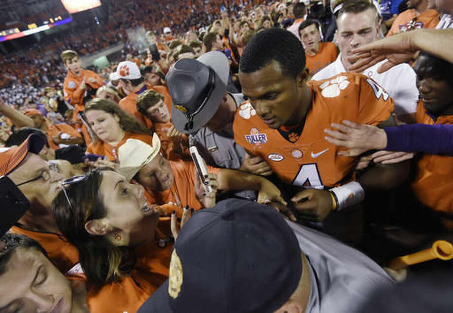 Clemson quarterback Deshaun Watson (4) walks off the field after Clemson defeated Louisville 42-36 in an NCAA college football game Saturday, Oct. 1, 2016, in Clemson, S.C. (AP Photo/Rainier Ehrhardt)