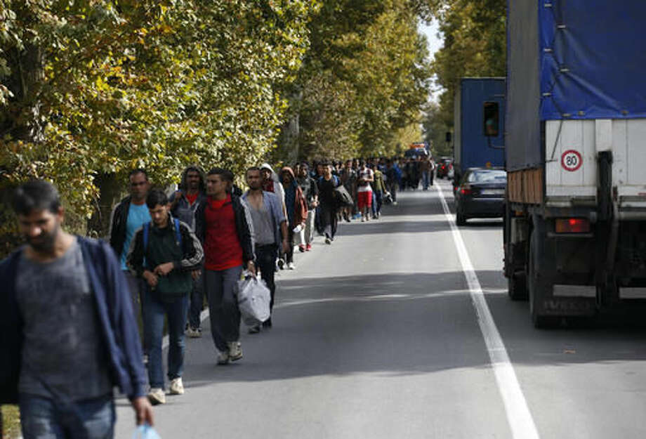 Migrants and refugees walk towards the Serbian border with Hungary near the Belgrade suburb of Batajnica, Serbia, Tuesday Oct. 4, 2016. Hundreds of migrants stranded in Serbia set off on foot on Tuesday toward the border with Hungary to protest its closure for most people trying to reach the European Union. (AP Photo/Darko Vojinovic)