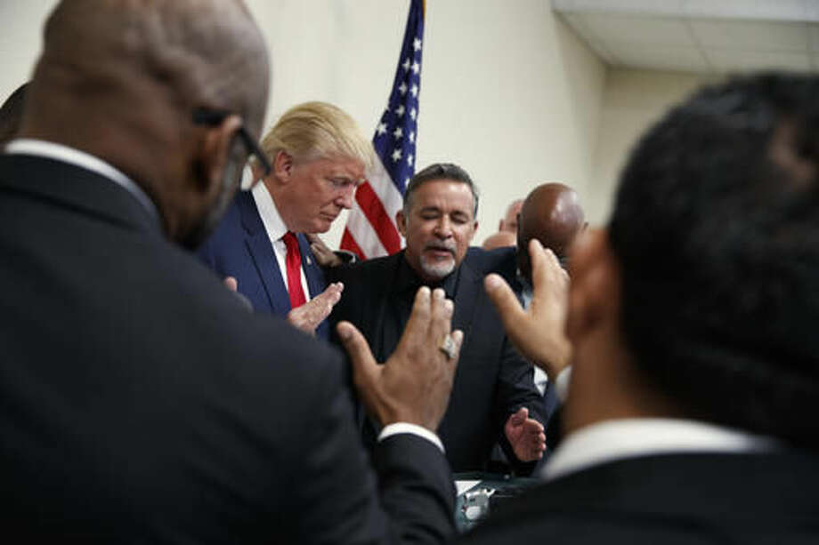 Pastors from the Las Vegas area pray with Republican presidential candidate Donald Trump during a visit to the International Church of Las Vegas, and International Christian Academy, Wednesday, Oct. 5, 2016, in Las Vegas. (AP Photo/ Evan Vucci)
