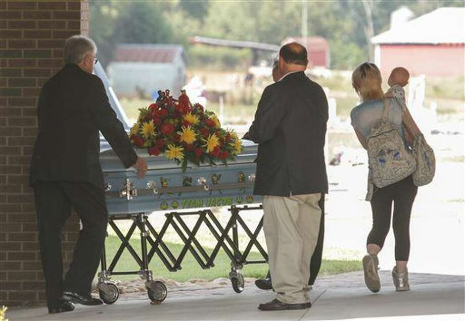 The casket of Jacob Hall arrives for a wake service at Oakdale Baptist Church in Townville, S.C., Wednesday, Oct. 4, 2016. Jacob, a classmate and a teacher were shot last Wednesday as they left for recess. Authorities say the suspect, a 14-year-old boy, had shot his father to death before driving to Townville Elementary. The other student and teacher were treated and released from a hospital that day. (Ken Ruinard/The Independent-Mail via AP, Pool)