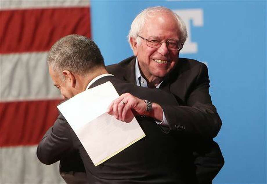 Sen. Bernie Sanders, I-Vt., greets Russ Feingold, Democratic candidate for the U.S. Senate, as he enters the stage to campaign for Democratic presidential candidate Hillary Clinton at Monona Terrace Community and Convention Center in Madison, Wis., Wednesday, Oct. 5, 2016. (Amber Arnold/Wisconsin State Journal via AP)