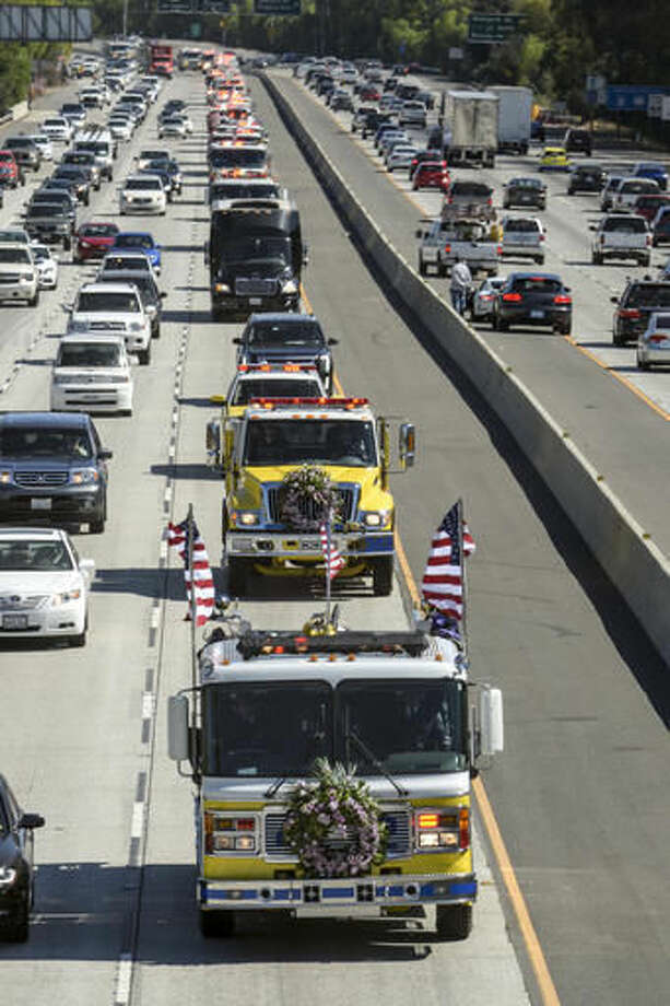 The body Ventura County Fire Engineer Ryan Osler leads the way on a fire truck in a convoy of fire engines down the 101 freeway in a convoy of fire engines to his final resting place Monday, Oct. 3, 2016. Osler was killed in a an accident while on duty on Sept. 21, 2016. Hundreds of firefighters from around the state attended the services. (David Crane/Los Angeles Daily News via AP)
