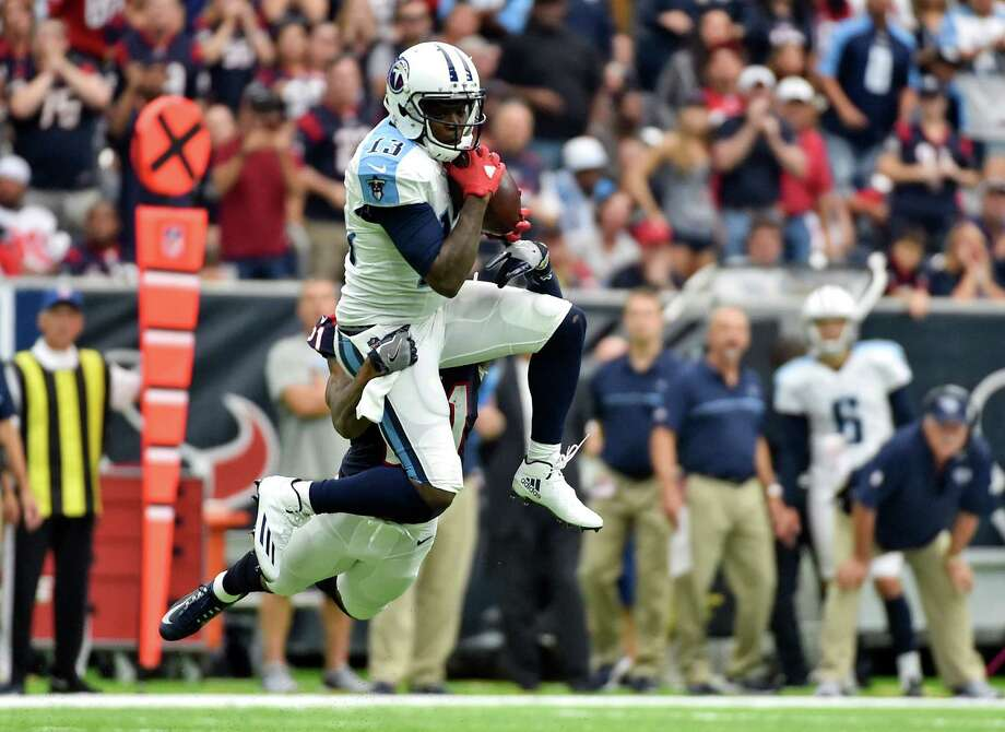 FILE - In this Oct. 2, 2016, file photo, Tennessee Titans wide receiver Kendall Wright makes a catch in front of Houston Texans cornerback A.J. Bouye (21) during the second half of an NFL football game in Houston. While his injured hamstring cost him all of the preseason and the first three games of the season, the fifth-year receiver is coming off one of the best performances of his career with the Colts coming in Sunday. (AP Photo/Eric Christian Smith, File) Photo: Eric Christian Smith, FRE / FR171023 AP