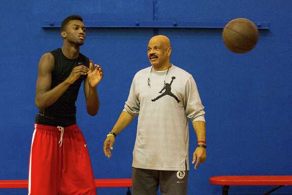 Drawing on his experience in the NBA and as a mentor to young and troubled individuals, John Lucas, right, believes helping a player shape who he is will make him a better competitors on the court.