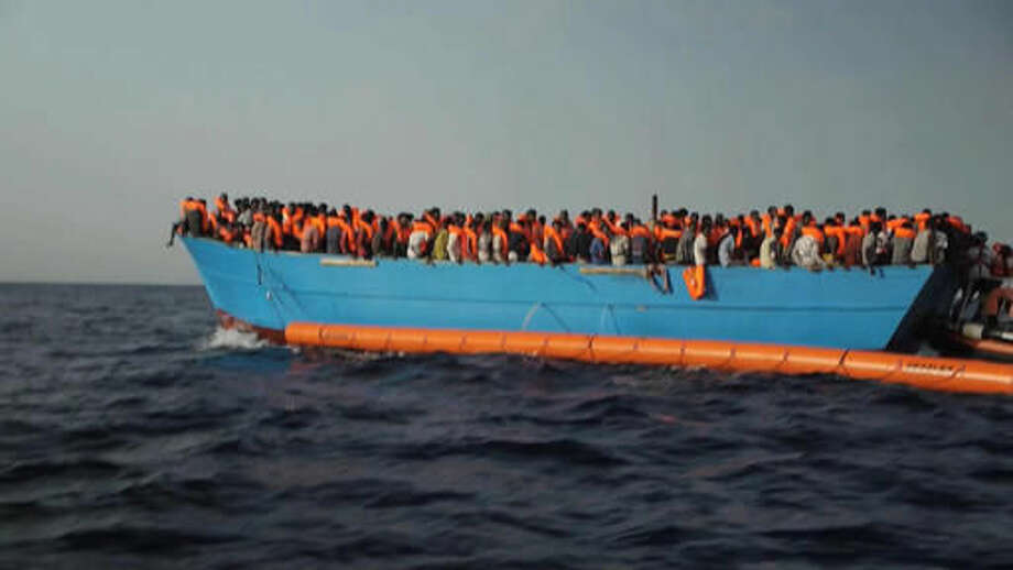 Migrants are crowded on to the vessel in the Mediterranean Sea off the coast of Libya in this Tuesday Oct. 4, 2016 image taken from video. At least 33 people died on Tuesday trying to reach Europe by crossing the Mediterranean Sea from Libya. (AP Photo)