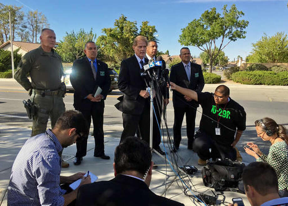 Los Angeles County Sheriff's Department Officer Neal B. Tyler, at podium, with other officials discuss LASD Lancaster Sheriff's Deputy involved shooting, and the loss of Sgt. Steve Owen, a 29 year veteran of the department, Wednesday, Oct. 5, 2016, in Lancaster, Calif. Authorities say 53-year-old Sgt. Owen died at a hospital Wednesday, several hours after he was shot while responding to a report of a burglary in a neighborhood in Lancaster, north of Los Angeles. (Nicole Nishida/Los Angeles County Sheriff's Department via AP)