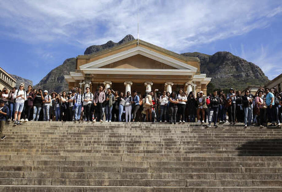 FILE - In this file photo dated Tuesday, Sept. 20, 2016, students gather at the University of Cape Town as they protest for free education in Cape Town, South Africa. Grievances over economic inequities are fueling unrest that has forced the closure of some of South Africa's most prominent universities, with the government alleging a radical minority has brought campuses to a standstill over financing of higher education. (AP Photo/Schalk van Zuydam, FILE)