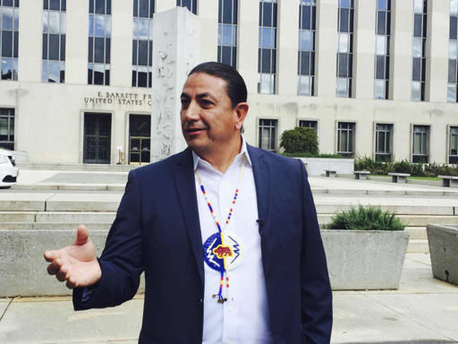 Dave Archambault, chairman of the Standing Rock Sioux Tribe, stands outside court in Washington courthouse, Wednesday, Oct. 5, 2016, where appeals court judges heard his tribe's challenge to the Dakota Access pipeline. A federal appeals court panel had tough questions for opponents of the $3.8 billion, four-state Dakota Access oil pipeline who are arguing to keep a temporary stop of construction in place. (AP Photo/Jessica Gresko)