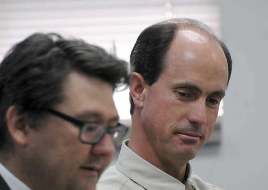 FILE - In this July 9, 2015 file photo, Seth Jeffs, right, brother of imprisoned polygamous sect leader Warren Jeffs, participates in a state water board meeting in Pierre, S.D. Polygamous sect leader Jeffs, charged with fraud, told a judge in Salt Lake City, Tuesday, Oct. 4, 2016, that not sharing goods purchased with food stamps would prohibit him and others from living their religion and being prepared for heaven. (AP Photo/James Nord, File)