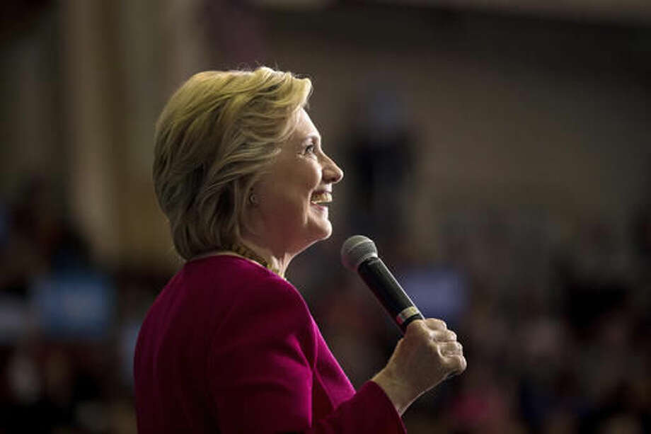 Democratic presidential candidate Hillary Clinton smiles while speaking at a rally at the Zembo Shrine in Harrisburg, Pa., Tuesday, Oct. 4, 2016. (AP Photo/Andrew Harnik)