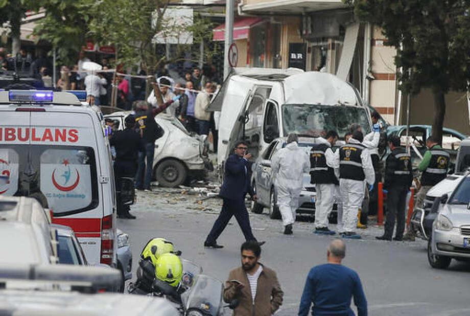 Police work at the scene of a blast in Istanbul, Thursday, Oct. 6, 2016. A bomb placed on a motorcycle has exploded near a police station Thursday, wounding several people, Vasip Sahin, the governor for Istanbul, said. (AP Photo/Emrah Gurel)