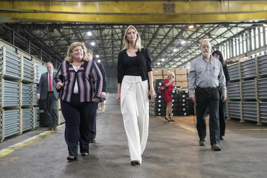Ivanka Trump, daughter of Republican presidential candidate Donald Trump, center, tours Middletown Tube Works, a welded steel tube supplier, alongside owner Angela Phillips, left, Thursday, Oct. 6, 2016, in Middletown, Ohio. (AP Photo/John Minchillo)