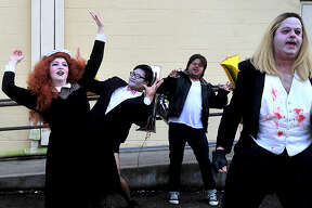 "Cast of Port Arthur Little Theater's ""Rocky Horror Picture Show"" demonstrate the steps to ""The Time Warp"" dance before the outdoor showing of ""The Rocky Horror Picture Show"" at the Betty Greenberg Center Thursday. Cast members from Beaumont Community Player's ""She Kills Monsters,"" cast from Port Arthur Little Theater's production of Rocky Horror, and members of the local Society for Creative Anachronism entertained before nightfall set in and the projection screen got rolling for the watch party of the televised cult musical classic. Photo taken Thursday, October 20, 2016 Kim Brent/The Enterprise"