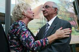 Harvey Najim is embraced by ChildSafe President and CEO Kim Abermethy on Thursday when Najim announced his $5 million donation to ChildSafe for a new state-of-the-art facility for abused children that will be built on the East Side.