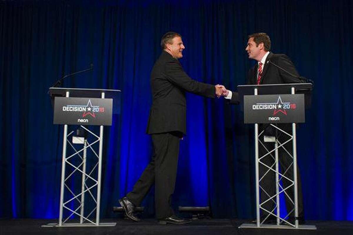 Republican gubernatorial candidate Chris Sununu and Democratic challenger Colin Van Ostern shake hands following a televised debate at New England College in Henniker, N.H., on Wednesday, Oct. 5, 2016. (Elizabeth Frantz/Concord Monitor via AP)