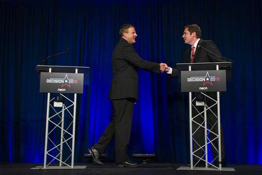 Republican gubernatorial candidate Chris Sununu and Democratic challenger Colin Van Ostern shake hands following a televised debate at New England College in Henniker, N.H., on Wednesday, Oct. 5, 2016. (Elizabeth Frantz/Concord Monitor via AP)