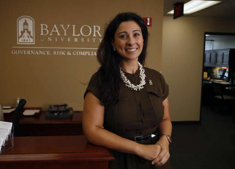 FILE - In this Aug. 1, 2015 photo, Patty Crawford, Baylor University's first full-time Title IX coordinator, poses in her office in Waco, Texas. Crawford has resigned over a disagreement in her role overseeing changes at the Baptist school following claims it mishandled sexual assault cases over several years, tgee university said in a statement late Monday, Oct. 3, 2016.(Rod Aydelotte/Waco Tribune-Herald via AP)