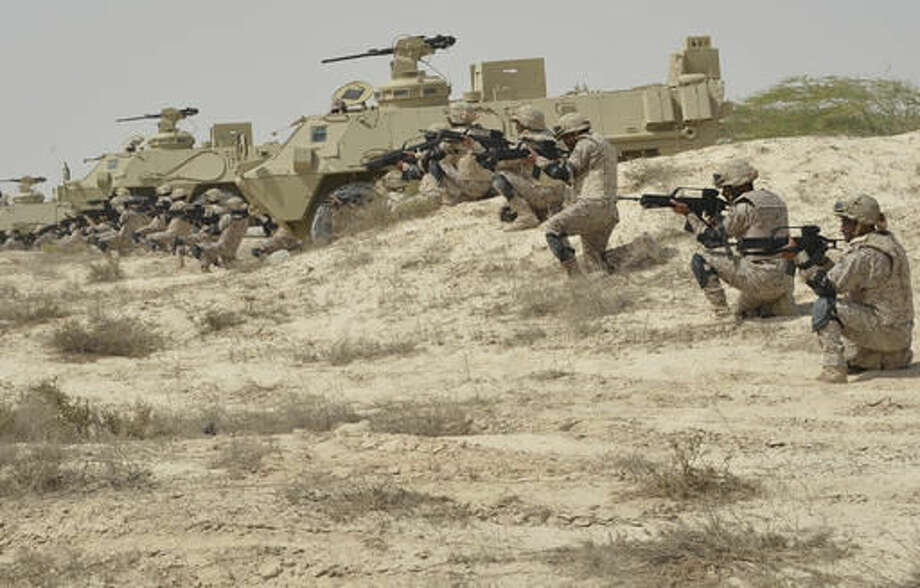 """In this undated photo released by Saudi Press Agency, SPA, Saudi military personnel conduct military exercises dubbed Gulf Shield One in Saudi Arabia. As the Saudis holds a naval drill in the strategic Strait of Hormuz, a powerful Iranian general has been quoted Wednesday, Oct. 5, 2016, as suggesting the kingdom's deputy crown prince is so """"impatient"""" he may kill his own father to take the throne. While harsh rhetoric has been common between the two rivals since January, the outrageous comments by Revolutionary Guard Gen. Qassem Soleimani take things to an entirely different level by outright discussing Saudi King Salman being killed. (Saudi Press Agency via AP)"""