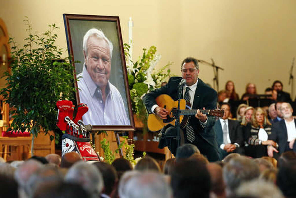 Country artist Vince Gill performs during a memorial service for golfer Arnold Palmer in the Basilica at Saint Vincent College in Latrobe, Pa., Tuesday, Oct. 4, 2016. (AP Photo/Gene J. Puskar)