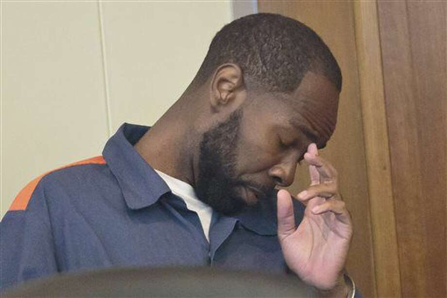 Ronald Earl Williams waits for his sentencing in front of Judge Timothy Hicks on Monday, October 3, 2016 at the Muskegon County Courthouse in Muskegon, Mich. Williams entered a no-contest plea on August 26, to second degree murder charge in the homicide and burial of Bobbie Maples. He was sentenced Monday to 18.5- to 55-years in prison by Judge Timothy Hicks. Maples disappeared in December of 2014. (Joel Bissell/Muskegon Chronicle-MLive.com via AP)