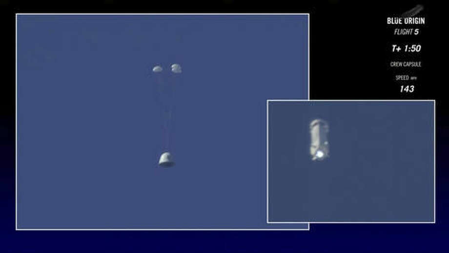 In this image made from video provided by Blue Origin, the New Shepard capsule, left, prepares to return to the ground as its booster rocket continues upwards during a test of the escape system in west Texas on Wednesday, Oct. 5, 2016. The escape system is designed to save lives if something goes wrong with the rocket during liftoff. (Blue Origin via AP)