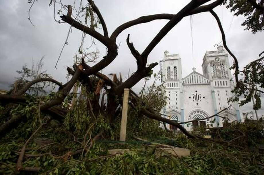 Trees are down outside a damaged church after the passing of Hurricane Matthew in Les Cayes, Haiti, Thursday, Oct. 6, 2016. Two days after the storm rampaged across the country's remote southwestern peninsula, authorities and aid workers still lack a clear picture of what they fear is the country's biggest disaster in years. (AP Photo/Dieu Nalio Chery)