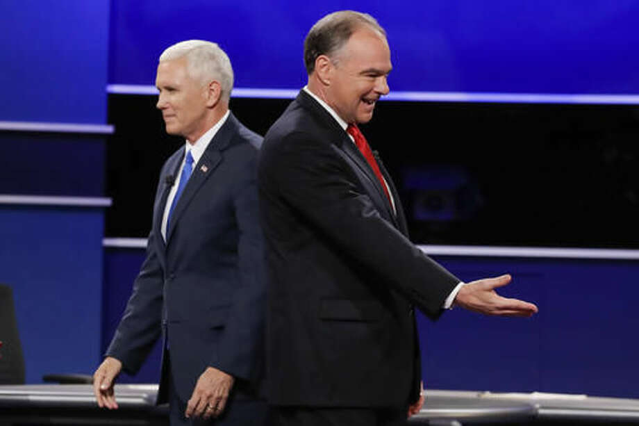 Republican vice-presidential nominee Gov. Mike Pence and Democratic vice-presidential nominee Sen. Tim Kaine, right, walk past each other after the vice-presidential debate at Longwood University in Farmville, Va., Tuesday, Oct. 4, 2016. (AP Photo/David Goldman)