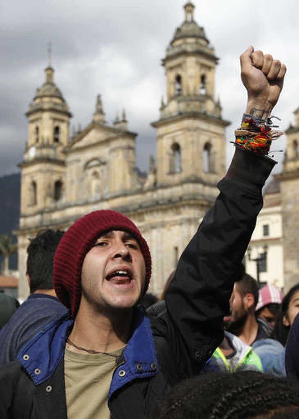A supporter of the peace deal signed between the Colombian government and rebels of the Revolutionary Armed Forces of Colombia, FARC, shouts slogans in front of Congress, in Bogota, Colombia, Monday, Oct. 3, 2016. Colombians rejected a peace deal with leftist rebels of the Revolutionary Armed Forces of Colombia, FARC, by a razor-thin margin in a national referendum Sunday, dismissing years of negotiations and delivering a setback to President Juan Manuel Santos. (AP Photo/Fernando Vergara)