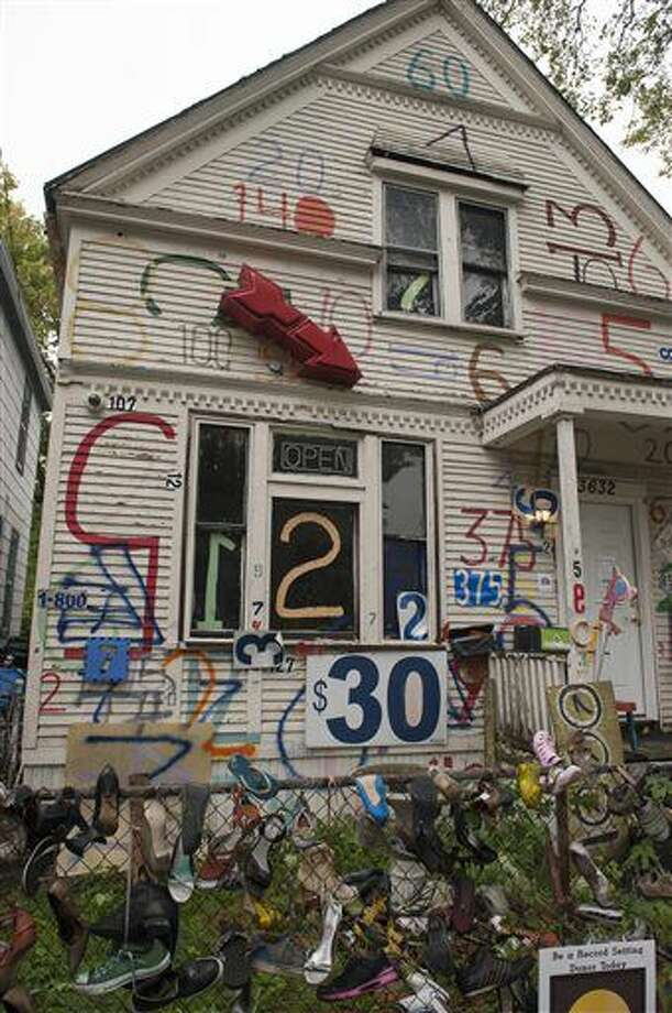 A Sept. 30, 2016 photo shows the exterior of the Number House at the Heidelberg Project, in Detroit. The Heidelberg Project in Detroit is launching a $100,000 capital campaign as its creator looks to remake and largely dismantle the outdoor art installation. (John T. Greilick/The Detroit News via AP)