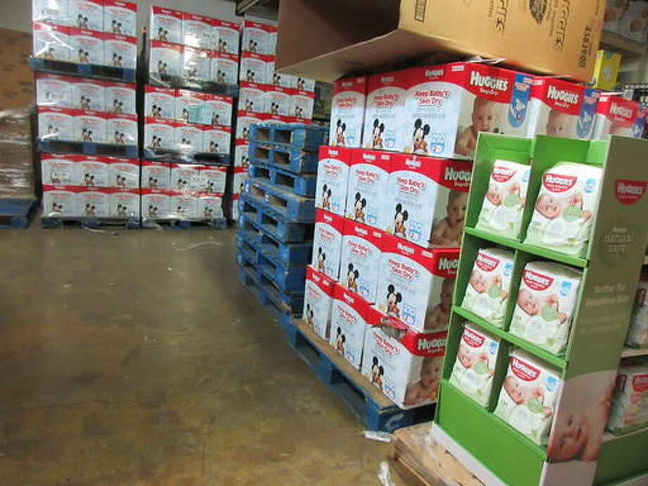 This Sept. 9, 2016 photo shows boxes of donated diapers stacked in a warehouse in North Haven, Conn. The National Diaper Bank Network, which operates the warehouse, distributes the diapers to agencies and community-based organizations like churches, which in turn provide them to families in need. (AP Photo/Beth J. Harpaz)