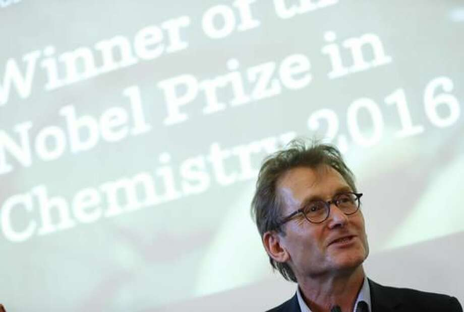 "Dutch scientist Bernard ""Ben"" Feringa speaks during a press conference at the University of Groningen in the Netherlands, Wednesday Oct. 5, 2016 Feringa was one of the three scientists who won the Nobel Prize in chemistry on Wednesday for developing the world's smallest machines, work that could revolutionise computer technology and lead to a new type of battery. (AP Photo/Peter Dejong)"