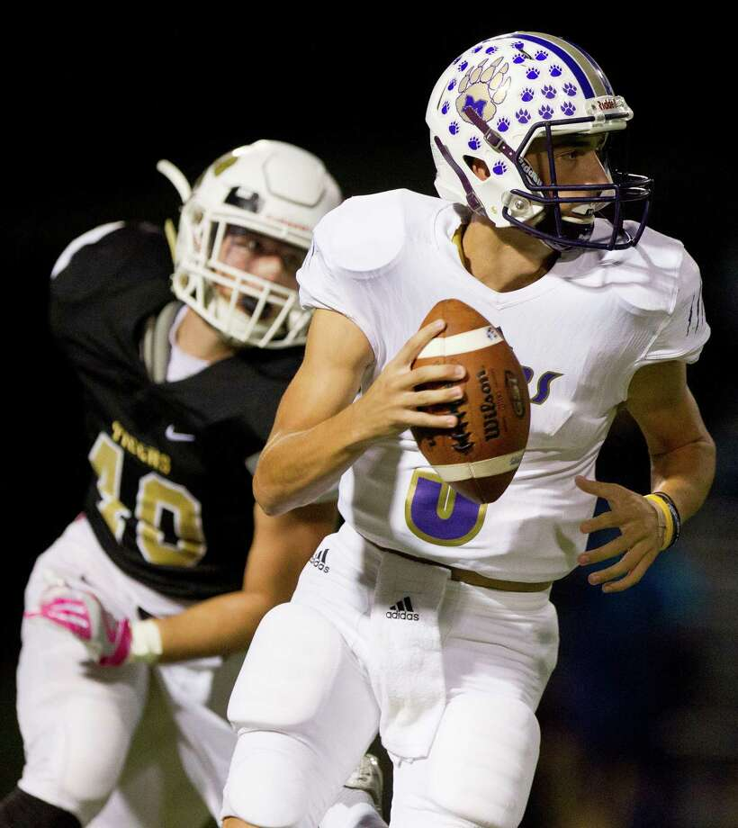 Montgomery quarterback Jordan Hood (5) is chased out of the pocked by Conroe linebacker Blake Doolen (40) during the first quarter of a District 12-6A high school football game at Buddy Moorhead Stadium Thursday, Oct. 6, 2016, in Conroe. Photo: Jason Fochtman, Staff / Houston Chronicle