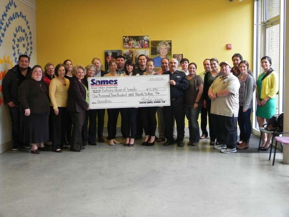 Bethany House and Sames Mazda representatives pose for a photo Tuesday at Bethany House after receiving a donation from Sames Mazda.