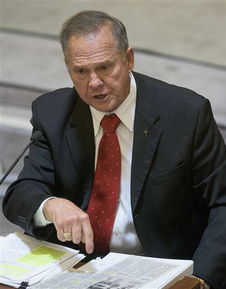 Alabama Chief Justice Roy Moore testifies during his ethics trial before the Alabama Court of the Judiciary at the Alabama Judicial Building in Montgomery, Ala., on Wednesday Sept. 28, 2016. He is accused of encouraging judges to defy the U.S. Supreme Court's ruling legalizing gay marriage. (Mickey Welsh/Montgomery Advertiser via AP, Pool)