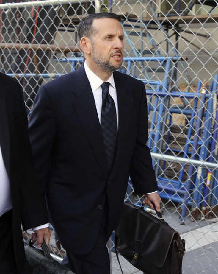 FILE - In a Friday, Sept. 23, 2016 file photo, David Wildstein arrives at the federal courthouse, in Newark, N.J. Wildstein testified Tuesday, Oct. 4, 2016, that New Jersey Gov. Chris Christie and New York Gov. Andrew Cuomo discussed releasing a false report to tamp down questions over the George Washington Bridge lane-closure scandal. (Chris Pedota/The Record via AP, File)