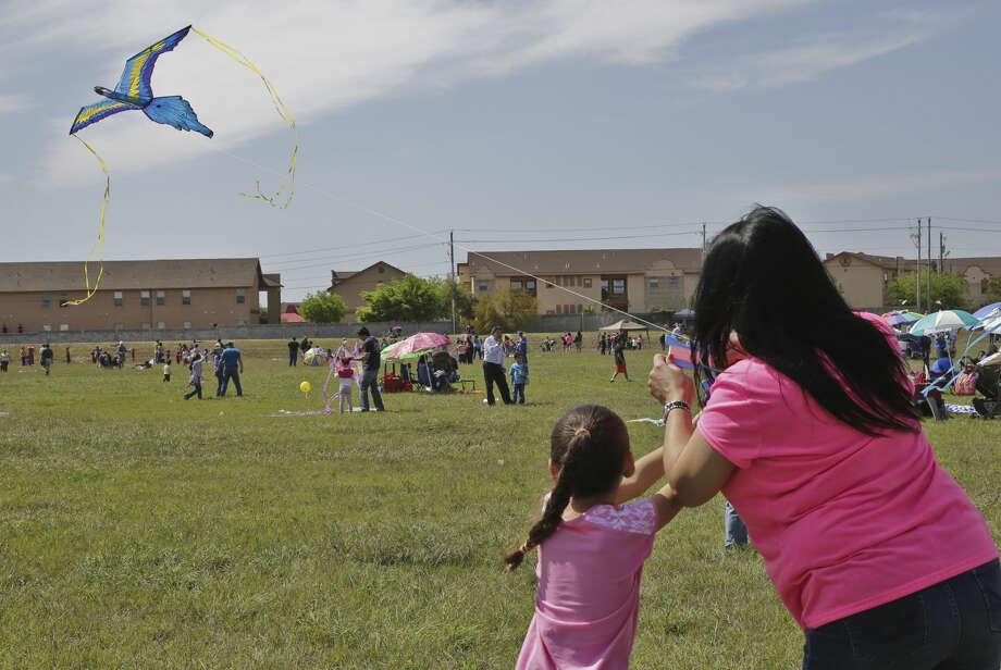 Zenayda Lopez, right, teaches Alejandra Villarreal, left, how to a fly a kite during the sixth annual Spring Break Kite Festival at North Central Park in March 2014.