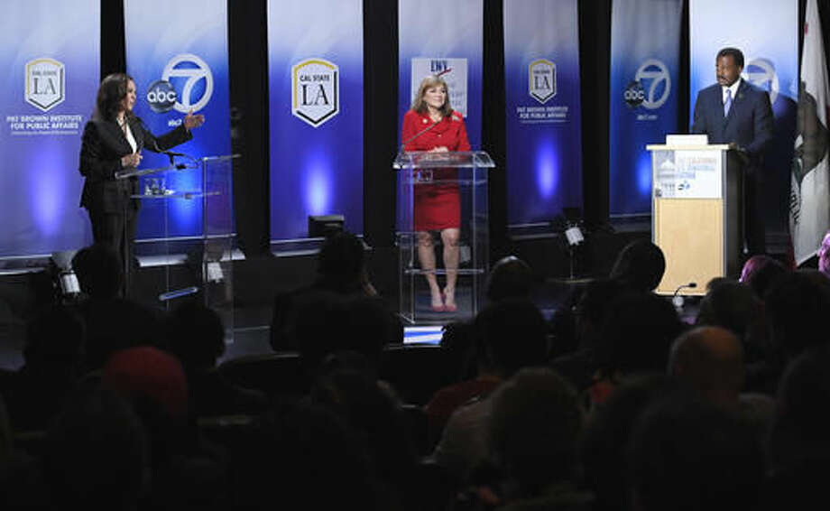 California U.S. Senate Democratic candidate California Attorney General Kamala Harris, left, speaks as Congresswoman Loretta Sanchez, center, listens along with moderator Marc Brown during a debate, Wednesday, Oct. 5, 2016, in Los Angeles. (AP Photo/Mark J. Terrill)